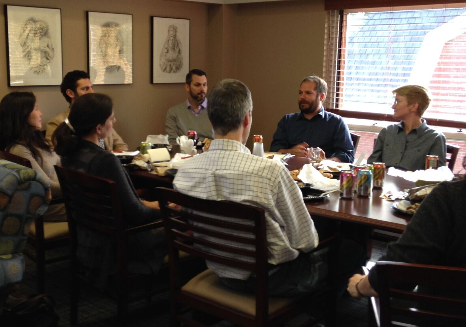 A small  faculty discussion group uses the conference table space in the Faculty Center.