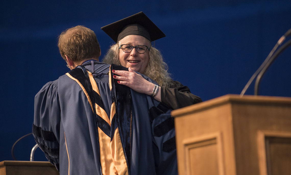 F&M President Daniel R. Porterfield embraces honorary degree recipient Dr. Rachel L. Levine, physician general for the Commonwealth of Pennsylvania.