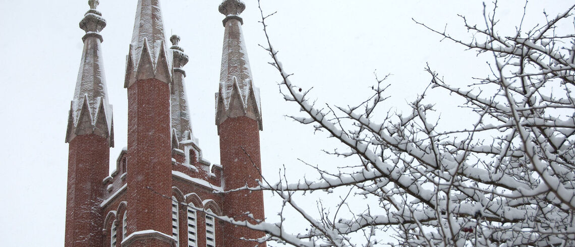 Snow covering Old Main tower