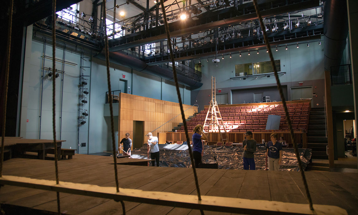 Preparing the stage for an elaborate set requires many hours of labor-intensive work.
