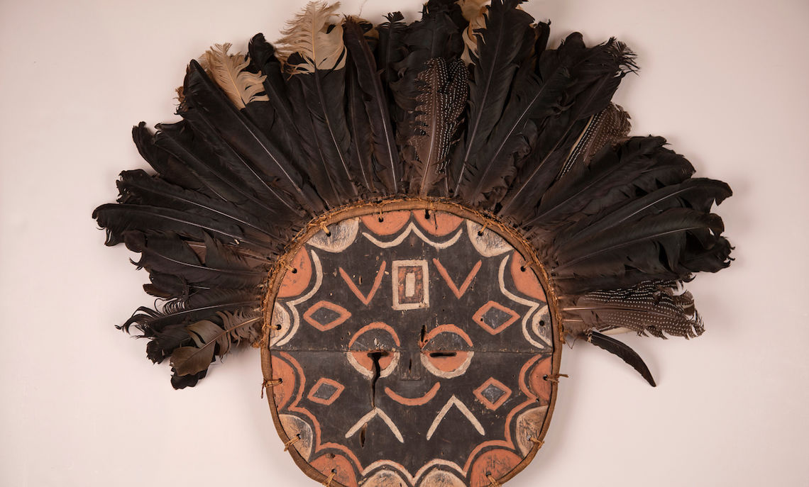 Disk mask with feathers from the Teke people of Central Africa, one of the Phillips Museum's newly acquired African masks, donated by Rita and Waldo Falkener '65.