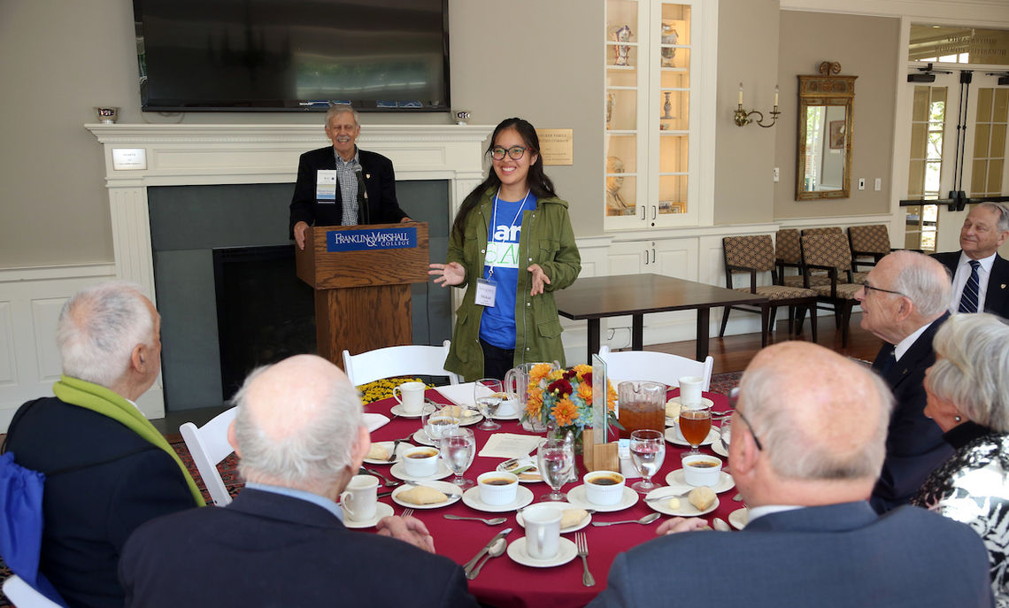 Sophomore Shikun Su introduces herself during the Nevonian Society Luncheon in Druker Family Humanities Common Friday afternoon.