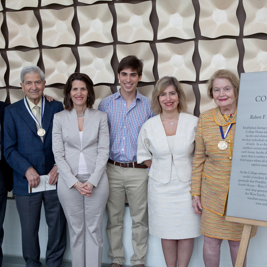 Members of the Weis family with the plaque of Weis College House (from left): Martin Laiks (husband of Colleen Ross Weis '85), Robert F. Weis, Colleen Ross Weis '85, Harrison Monsky (son of Jennifer Weis Monsky), Jennifer Weis Monsky and Patricia Ross Weis P'85.