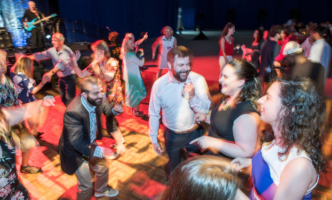 Friends and former classmates cut a rug at the Blue & White Bash.
