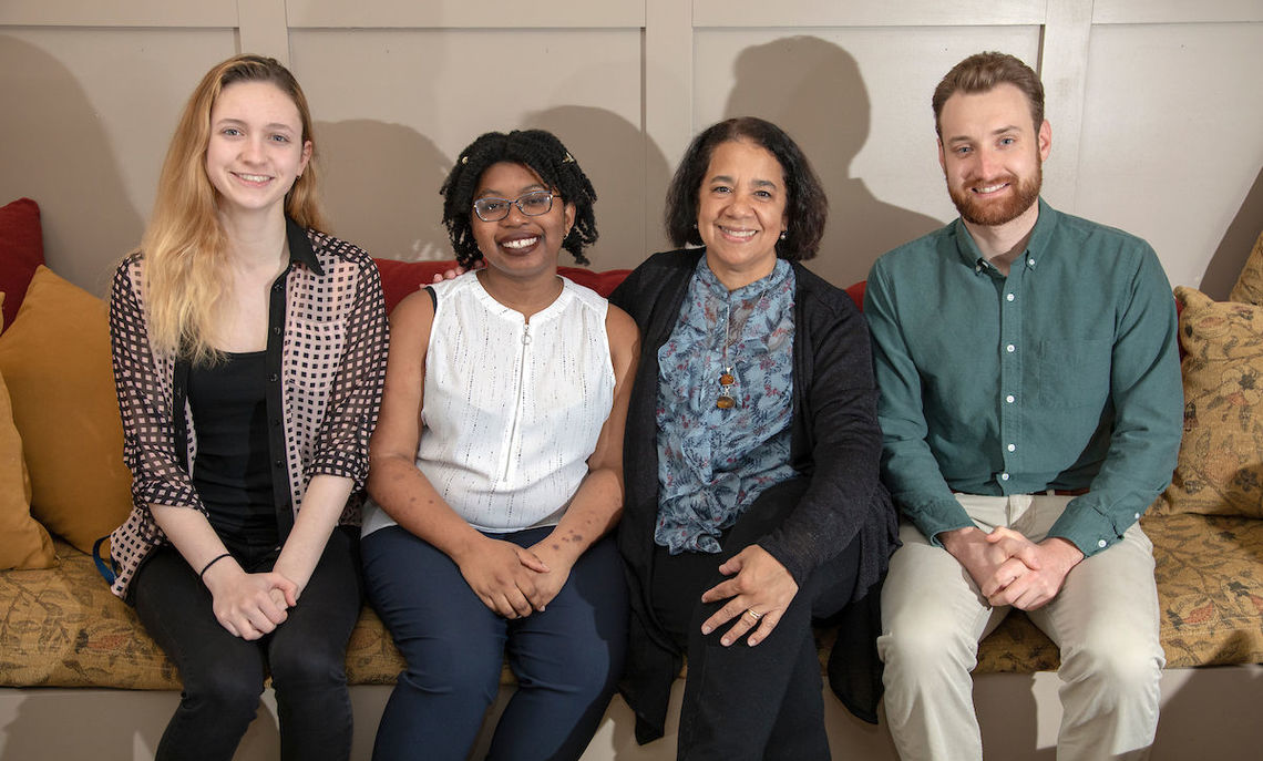 Short-story author Carolyn Ferrell sits with this year's Bank Prize winner, junior Noah Williams, and the runner-ups, junior Kaycee Green and first-year Olivia Hefferman.