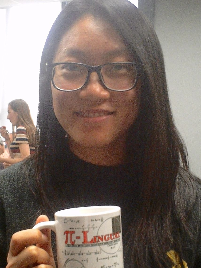 Chengcheng Zhai '18 holds a math mug gift for her service as Math Honorary Society Pi Mu Epsilon president and leader of the F&M Math Club during academic year 2017-18.