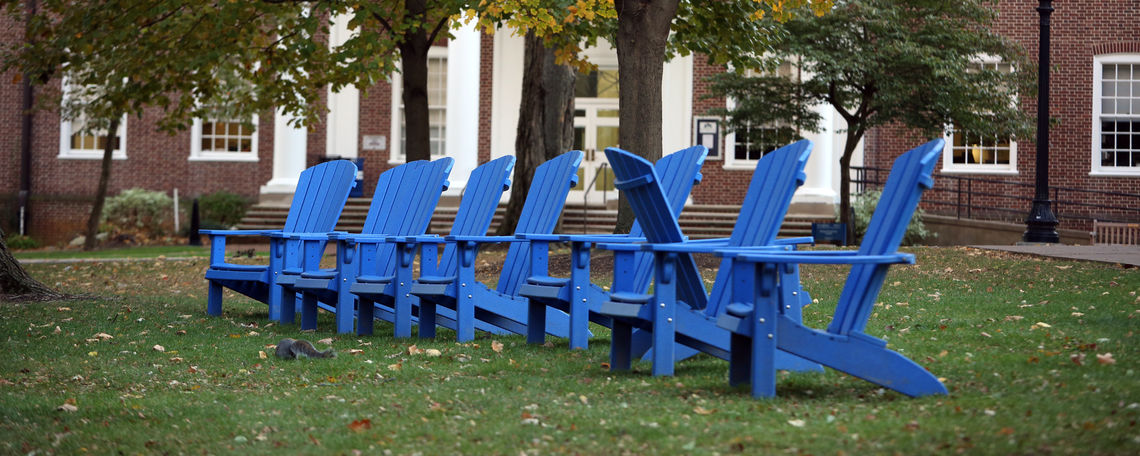 Blue chairs on campus on Halloween