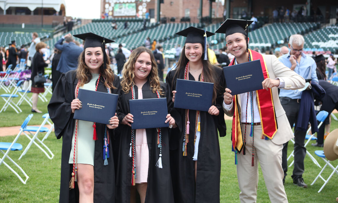 Members of the Class of 2021 display their diplomas during F&M Commencement held May 15 at Lancaster Clipper Stadium.