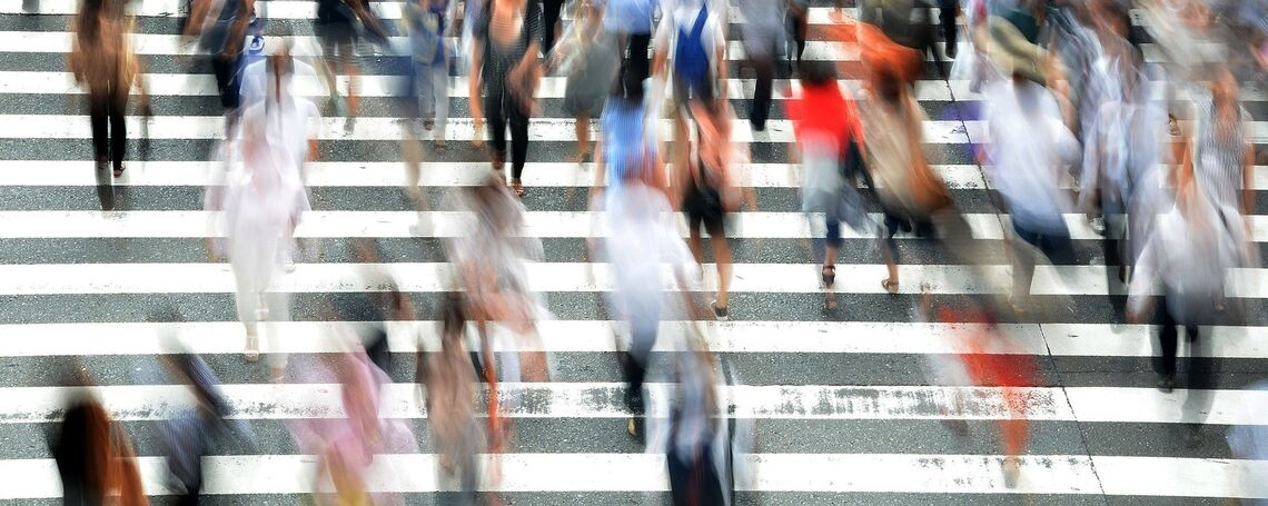 Crowded city with pedestrians walking