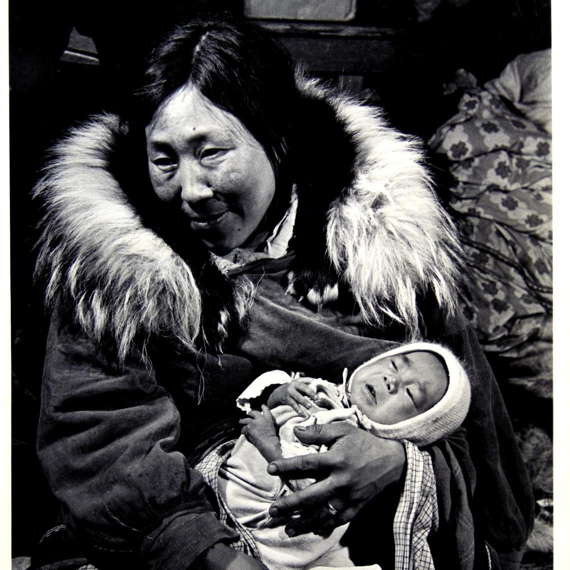 "Burt Glinn (American, 1925–2008). Native American Family–a Nunumaiute mother holding baby, Alaska, 1953. Gelatin silver print, 9 ⅜ x 6 ⅜"". Gift of Dr. Stephen J. and Eileen Nicholas, P'20, BG-192."