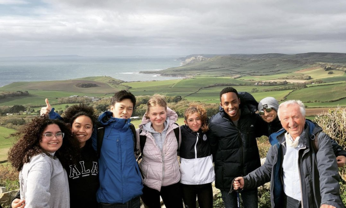 First-year international students in F&M's Bath cohort hiking along the Dorset coastline