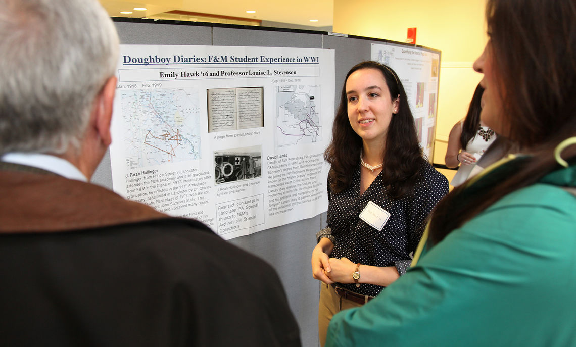 Senior Emily Hawk discusses one of two research projects she conducted last  summer. This year's spring fair on April 15 is in the Martin Library of the Sciences.