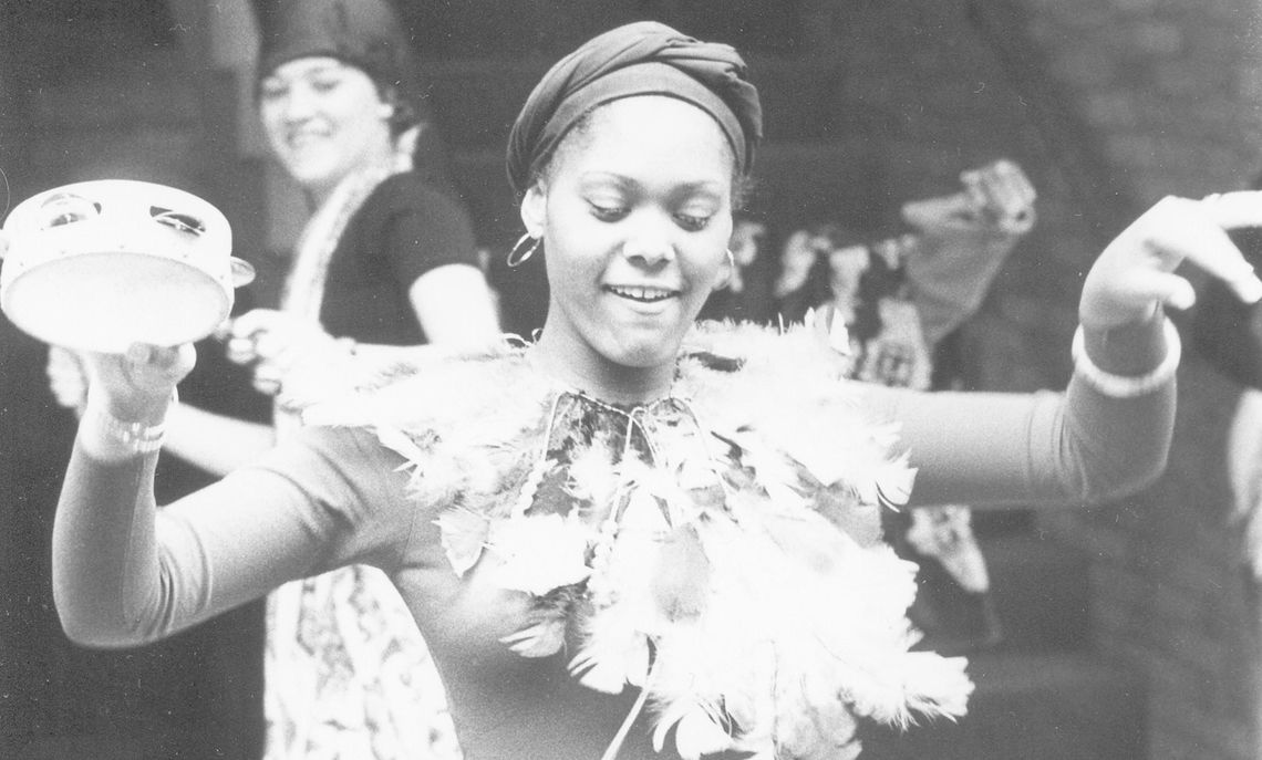 Linda M. Coleman, class of 1979, dances at an event sponsored by the Black Student Union in the Atrium of the Steinman College Center.