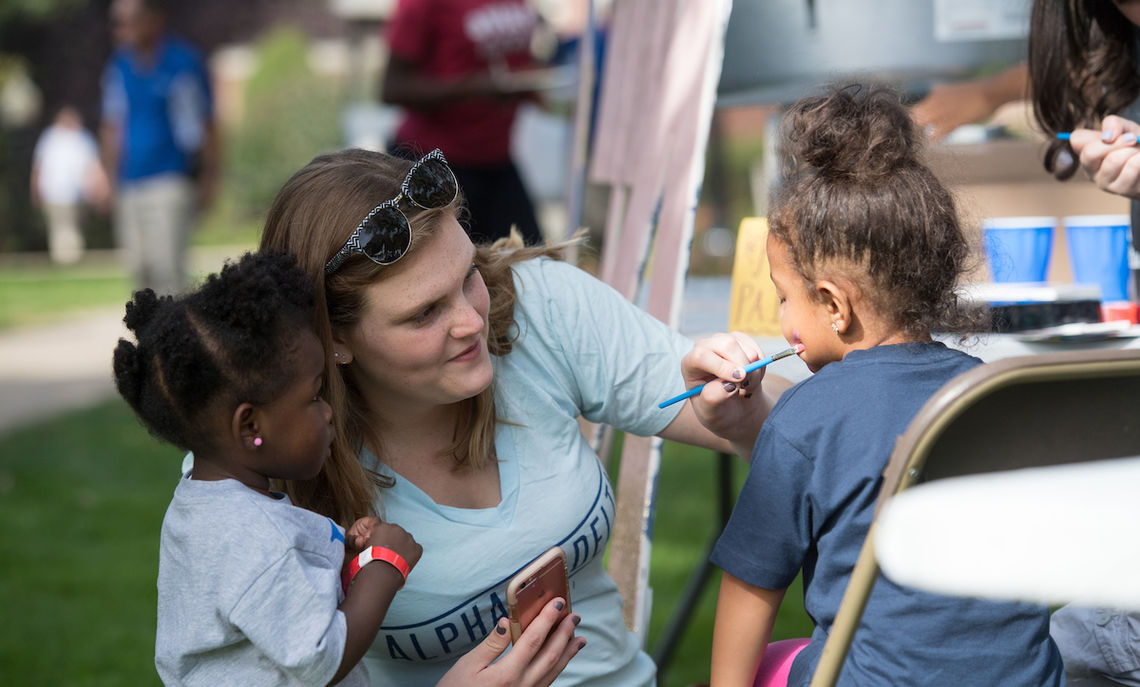 … Alpha Xi Delta sisters provided games and face painting …