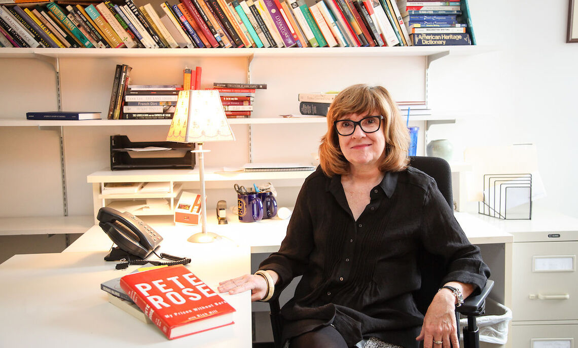 "F&M English Professor Patricia O'Hara, with a memoir by Pete Rose, was recently informed by the Hall of Fame about the decision to add to its library collection the playbill to her play, ""Banned in Baseball."""
