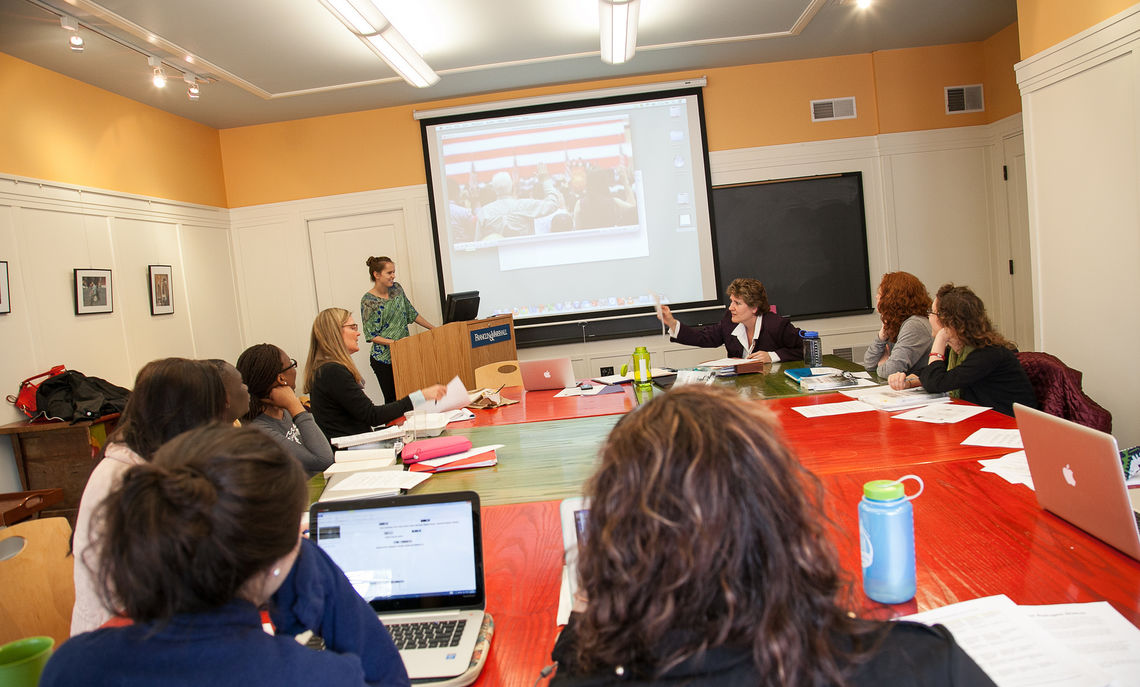 Students participate in a discussion during a Human Rights-Human Wrongs course that is taught by Susan Dicklitch and Karen Herrling. As part of the course, students work on cases for asylum seekers.