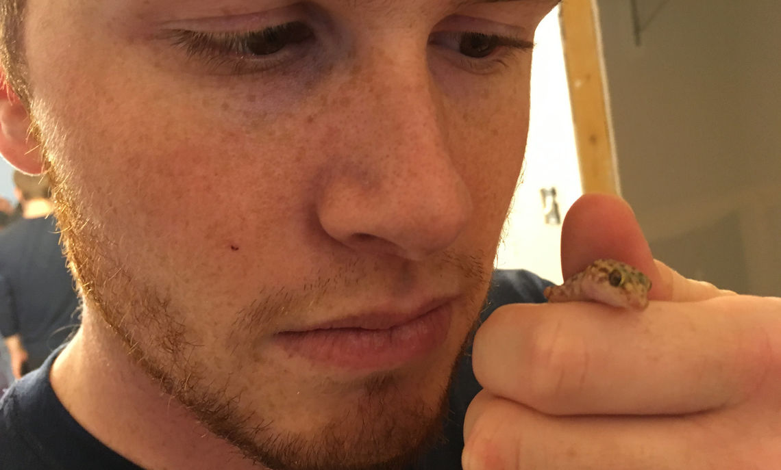 Tyler Donaghy,a junior, makes friends with a gecko.