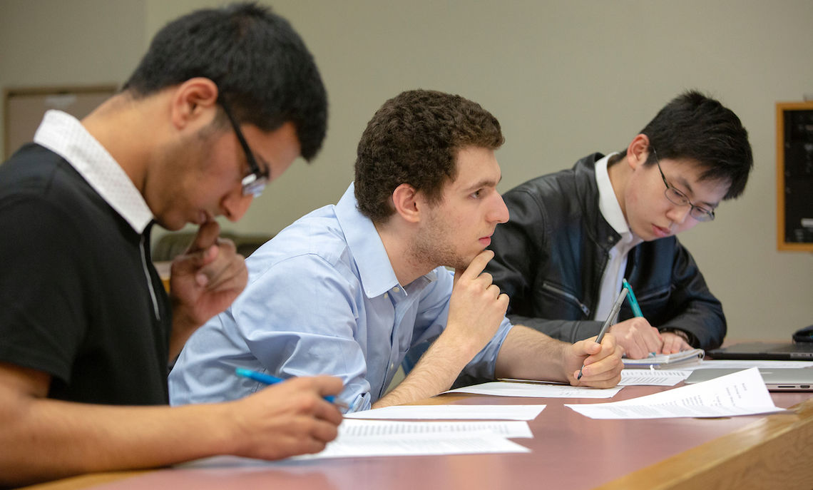 As the pro-team, first-years Husaini, Robert Litsky and Yoshiki Sakamoto argue for foreign aid and American intervention.