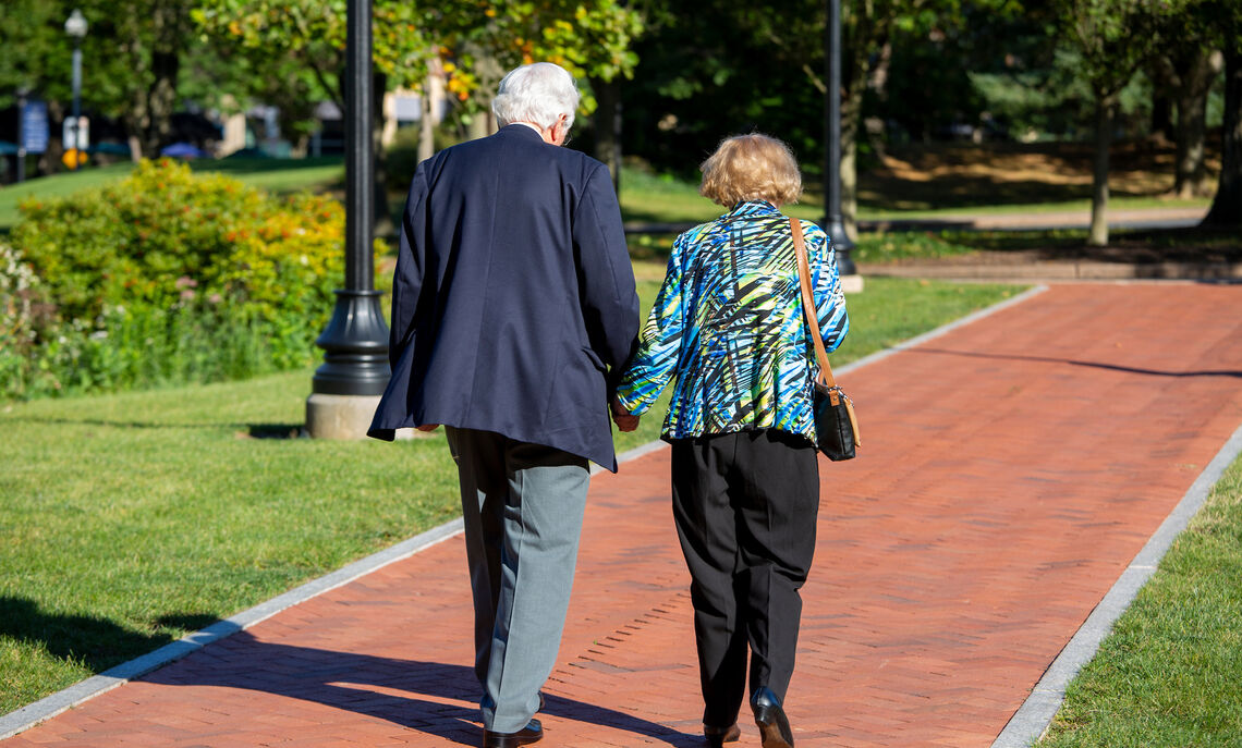 "Dr. Robert '54 and Anna Roschel stroll the familiar grounds of F&M. ""His happiest days were here in education,"" Mrs. Roschel said of her husband."