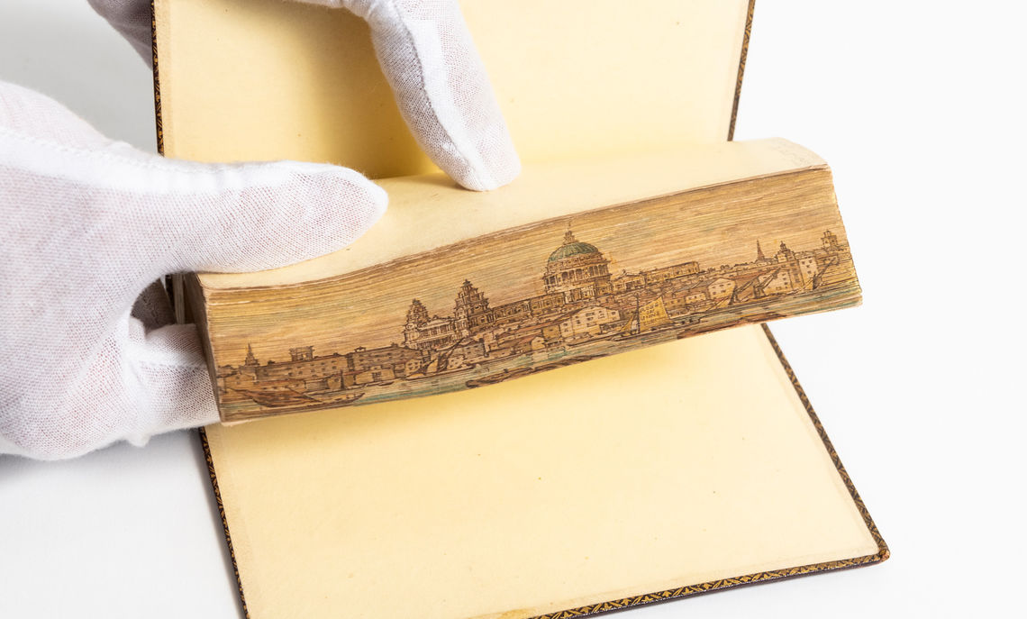 """Remains of the Late Rev. Charles Wolfe ... With a Brief Memoir of His Life,"" an example of fore-edge painting from 1838. This includes a painting of St. Paul's Cathedral in London."
