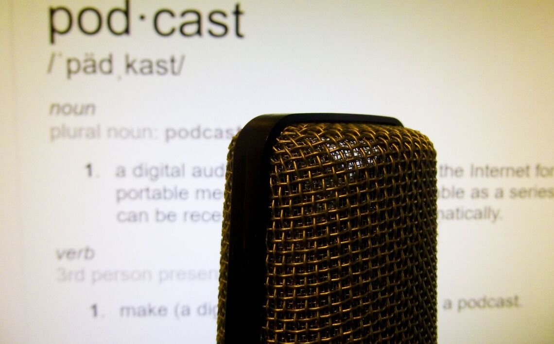text with a definition of a podcast and microphone