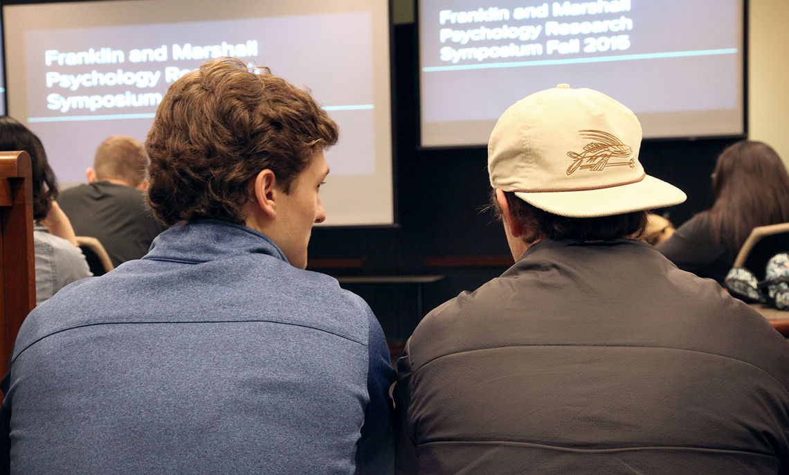 Aspiring psychology majors listen and question fellow students' projects.