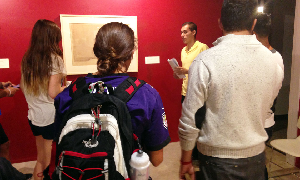 """As Assistant Professor of French Carrie Landfried's students listen to a student tour guide explain the """"Architecture and the Great War"""" exhibit at F&M's Phillips Museum of Art, the the students abroad were experiencing some of the history behind the exhibit."""