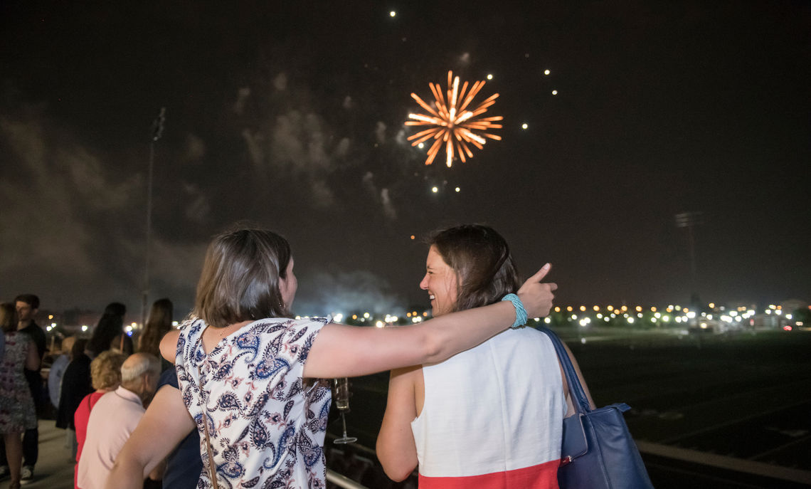 Alumni enjoy surprise fireworks from Shadek Stadium at the end of the night.