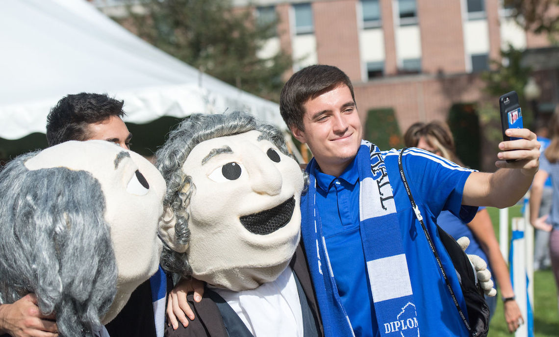 At the Tailgate on Hartman Green, students posed with Ben & John …