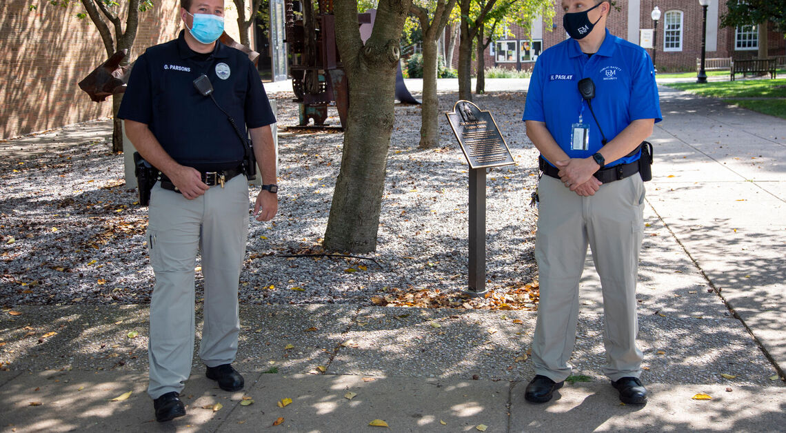 Public Safety Police Officer Gary Parsons and Security Officer, Howard Paslay in their new uniforms while on campus.