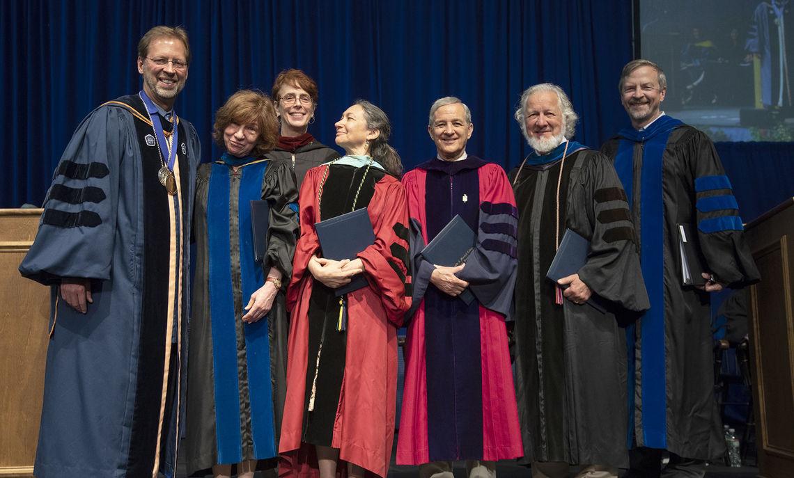 F&M President Daniel R. Porterfield, left, honors retiring faculty members Annette Aronowicz, Virginia Maksymowicz, Lynn Brooks, Joel Eigen and Fred Owens '72. At far right is Provost Joel Martin.