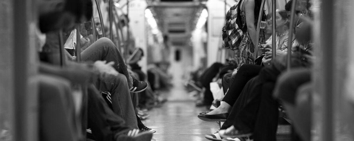 Stock image of people sitting on subway train.
