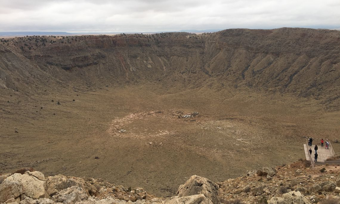 View of Meteor Crater near Winslow, the result of an asteroid impact 40,000 years ago. It is the best-preserved impact crater on the earth, according to de Wet. It was used to train Apollo astronauts, and is studied to understand impact processes on Earth and other planets.