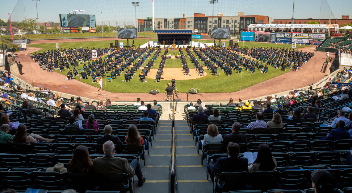 Members of the Class of 2021 – with family and friends watching from Lancaster Clipper Stadium seats –wait to receive their diplomas during F&M Commencement held May 15.