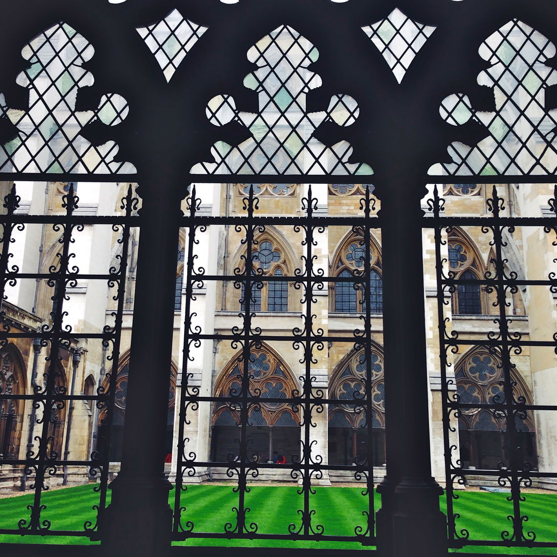 Wrought-iron latticework frames Gülce Tuncer's view of the inner courtyard in Westminster Abbey, England's most famous church. The London church, with a history stretching back over a thousand years, is the site of the coronations of British royalty.