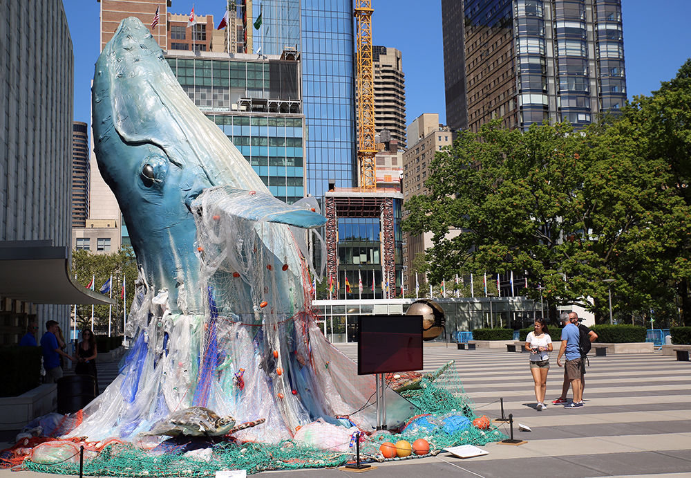 Whale in trash installation