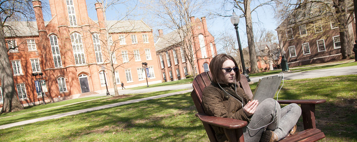 Student with iPad in Front of Old Main