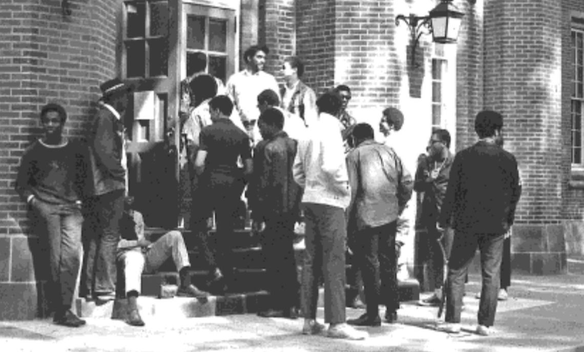 Students on the steps of Goethean Hall during the protest.