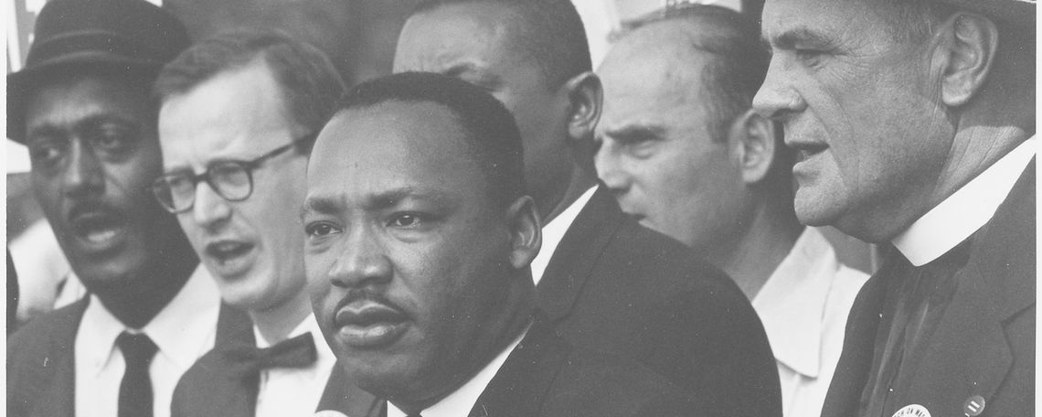 Civil rights march on Washington DC in August 1963 with Dr. Martin Luther King Jr. and Mathew Ahmann in a crowd.
