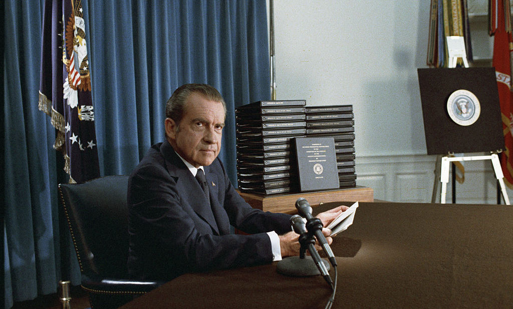 Nixon, with stacks of edited transcripts from the taped  conversations in the White House, during an April 29, 1974 broadcast to the nation.