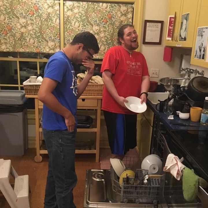 Writers House staffer and senior Phil demonstrates how to (happily) load a dishwasher to first year student and staffer Omar. 9/14/16