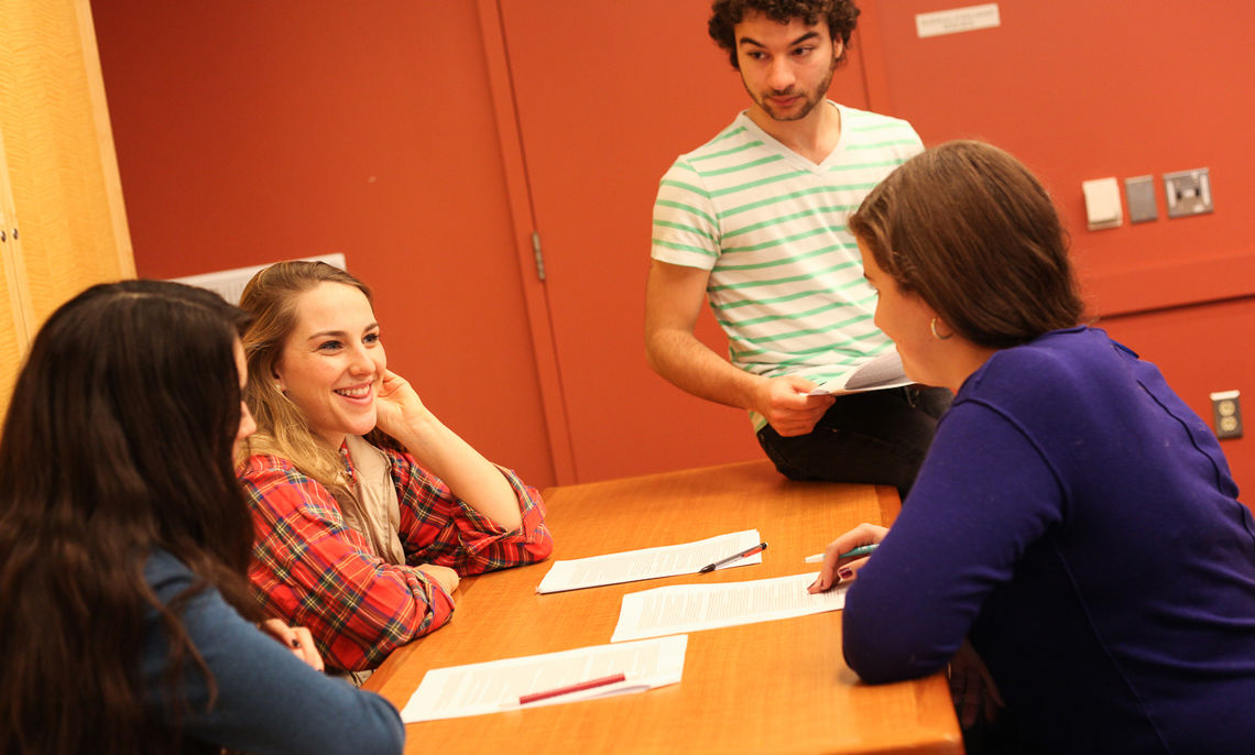 """Eduardo Alsina, one of Assistant Professor of French Carrie Landfried's class preceptors, collaborates with other students about what to share with the students abroad. """"We built up a relationship with the F&M students in Paris,"""" Alsina says."""