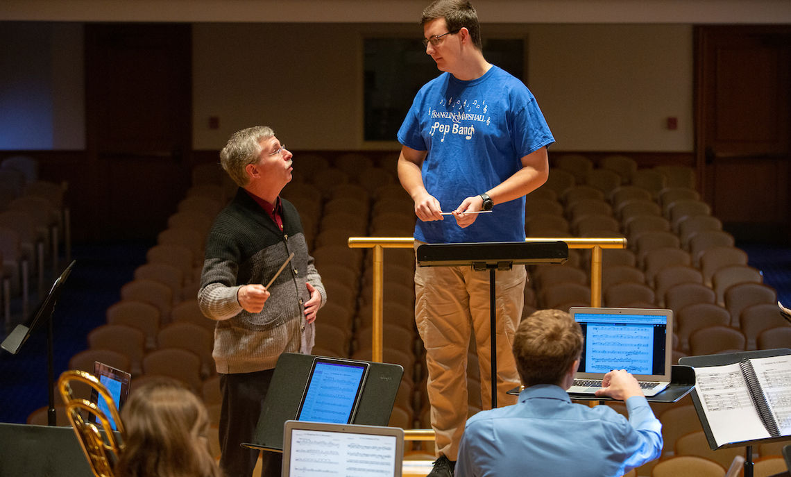 First-year Tyler Sauers listens as Norcross' instructs during conducting class.