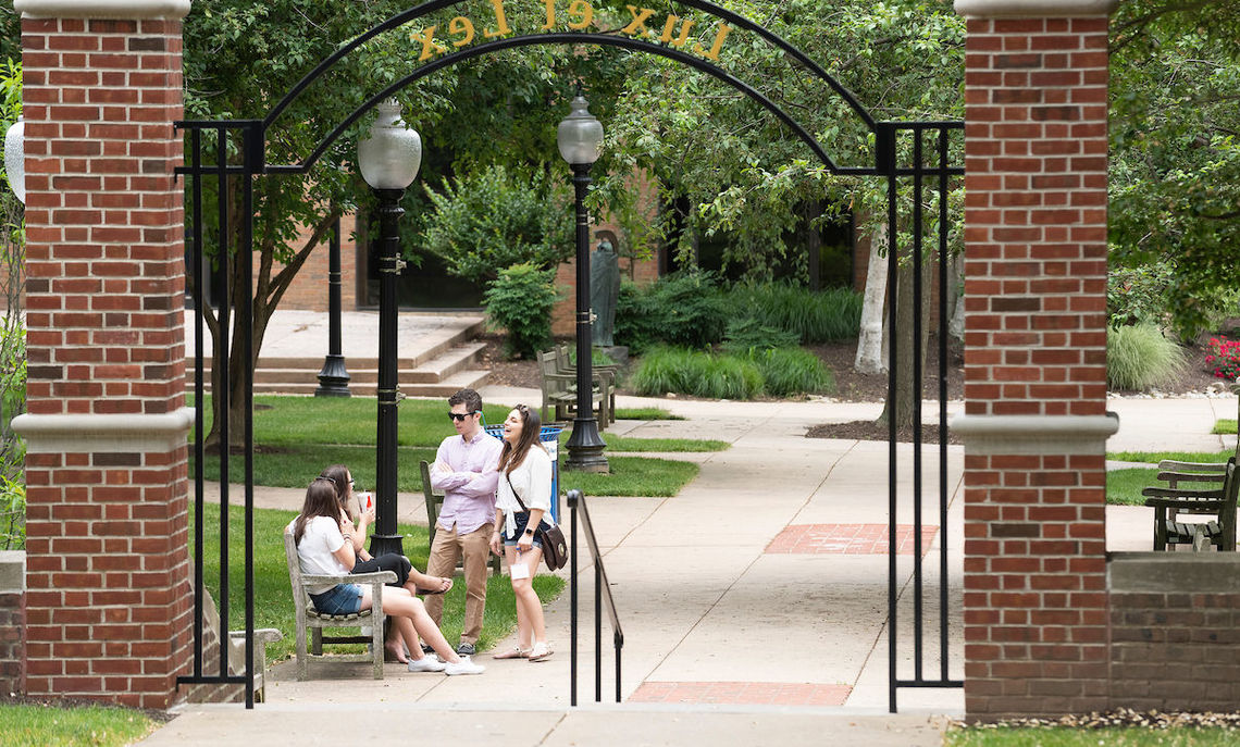 Friends find a corner of campus to share memories.