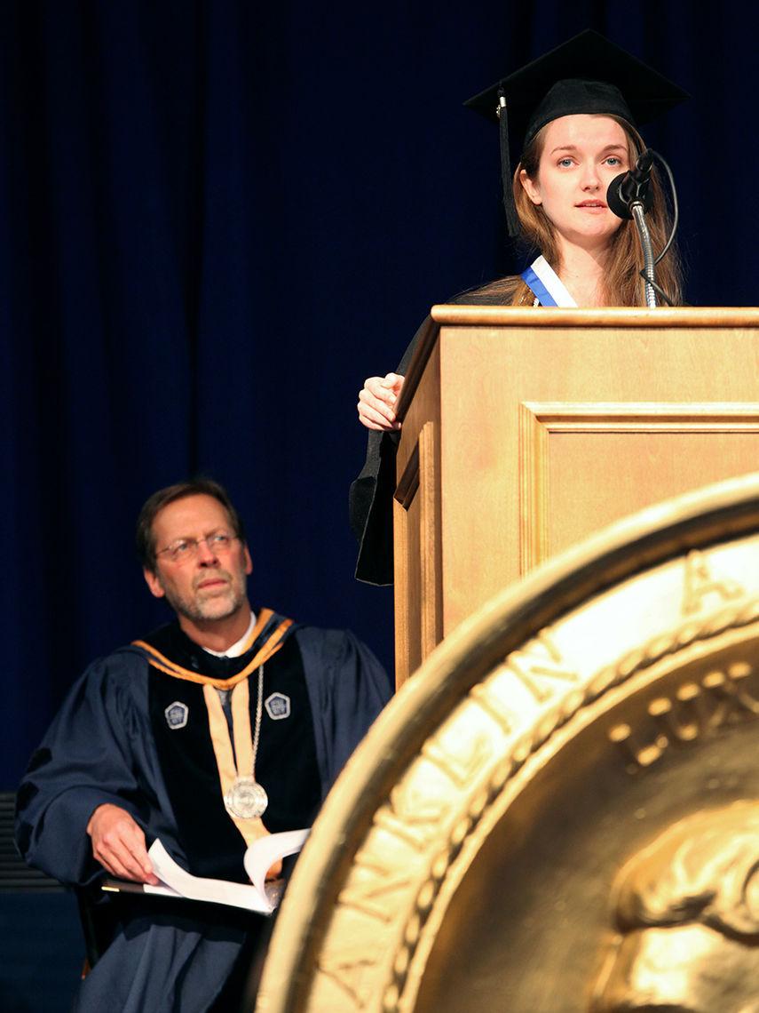Williamson Medal winner Morgan Kincade '16 speaks during Franklin & Marshall College's 2016 Commencement ceremony while President Daniel R. Porterfield looks on.