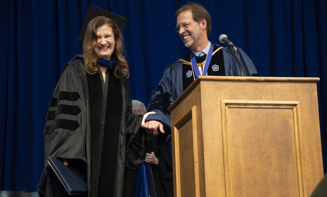 Honorary degree recipient Nicole F. Hurd, CEO of College Advising Corps, shares a laugh with longtime friend Daniel R. Porterfield, president of F&M.