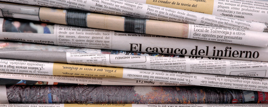 Barcelona, Spain - September 7, 2011: Pile of Spanish papers. Newspaper from Barcelona, La Vanguardia, founded in 1881 and nowadays one of the best selling spanish newspapers.