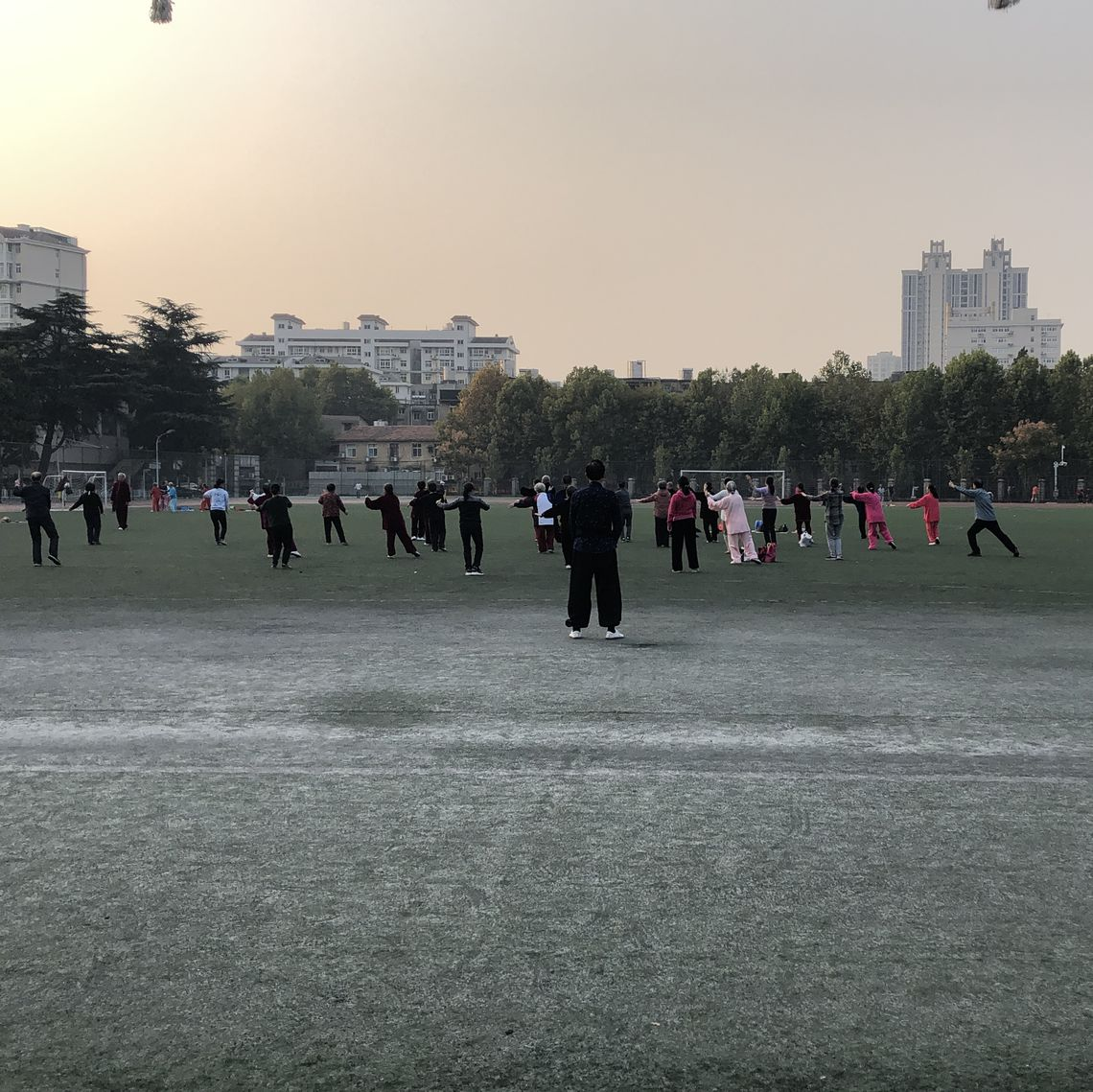 Wuhan residents practicing tai chi as the sun rises.