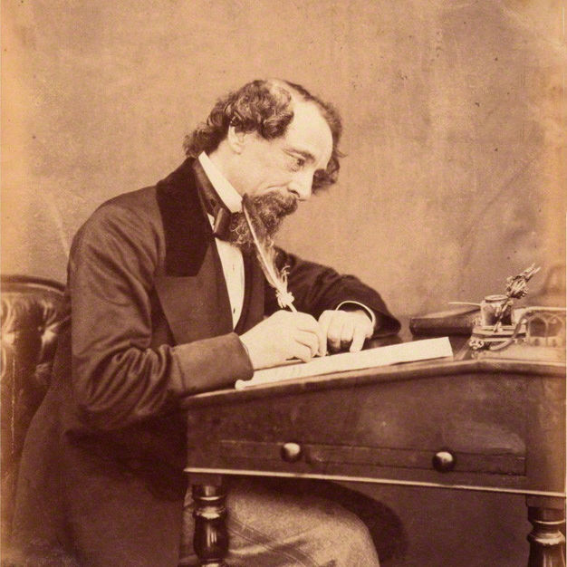 The best of times -- novelist Charles Dickens at his writing desk in 1858.