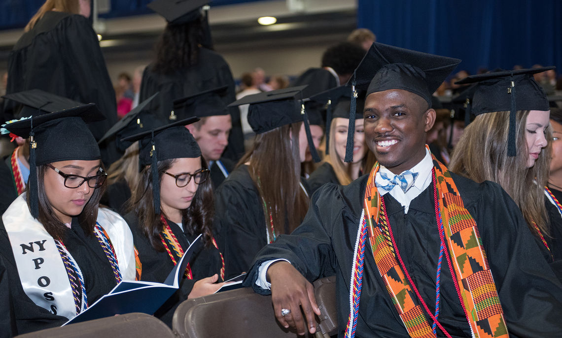 Graduating senior Donnell Bailey strikes a relaxed pose in the minutes running up to the beginning of Saturday's Commencement ceremony.
